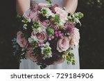 bride holding her boho wedding ...   Shutterstock . vector #729184906
