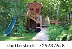 Kids wooden handcrafted crooked playhouse