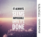 """Small photo of Inspirational motivating quote on background, """"it always seems impossible until it's done"""""""