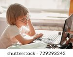 little blond kid with laptop | Shutterstock . vector #729293242