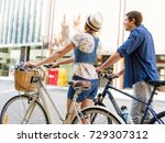 happy couple in city with bike | Shutterstock . vector #729307312