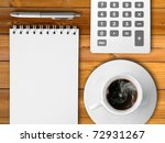 White calculator and white note paper with pen and white cup of hot coffee on Black table - stock photo