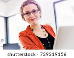young woman in office | Shutterstock . vector #729319156