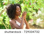 content black woman smelling... | Shutterstock . vector #729334732