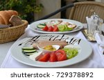 two plates with nicely served ... | Shutterstock . vector #729378892