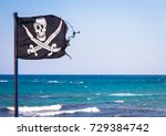 A Damaged Pirate Flag During A...