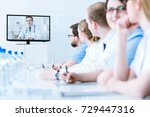 young interns listening to... | Shutterstock . vector #729447316