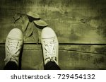 Close Up Of White Shoes And A...