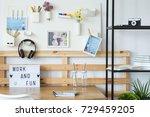shelf with photo camera in cozy ...   Shutterstock . vector #729459205