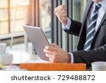 young businessman got a good... | Shutterstock . vector #729488872