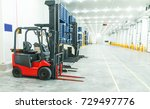 warehouse freezer forklift  | Shutterstock . vector #729497776