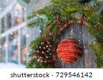 christmas wreath on a door with ... | Shutterstock . vector #729546142