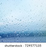 rian drop on glass color | Shutterstock . vector #729577135