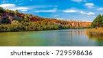 autumn colors on lake. rusenski ... | Shutterstock . vector #729598636