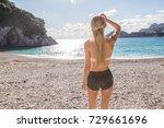 female from the back standing... | Shutterstock . vector #729661696