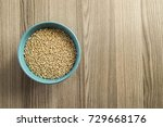 white wheat grains on a wooden... | Shutterstock . vector #729668176