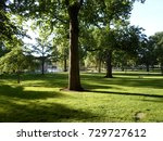 trees  grass and lagoon  boston ... | Shutterstock . vector #729727612