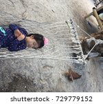 child sleeping on a hammock at... | Shutterstock . vector #729779152
