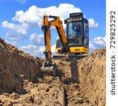 Modern Excavator Performs...