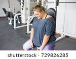 fat girl in a gym | Shutterstock . vector #729826285