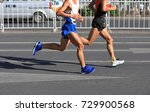 marathon runners running on... | Shutterstock . vector #729900568