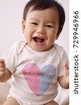 asian baby wearing white...   Shutterstock . vector #729946966