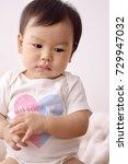 asian baby wearing white...   Shutterstock . vector #729947032