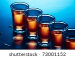 drink shots in blue and warm light - stock photo