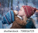 child is kissing a teddy bear... | Shutterstock . vector #730016725