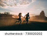 lovers in the rain spray | Shutterstock . vector #730020202