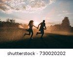 lovers in the rain spray | Shutterstock . vector #730020202