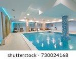 indoor swimming pool in hotel... | Shutterstock . vector #730024168