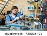 modern mechanic repairing chain ... | Shutterstock . vector #730036426