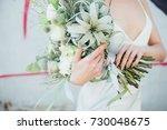 woman holds a spring flower...   Shutterstock . vector #730048675