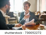 laughing businesswoman with... | Shutterstock . vector #730052272