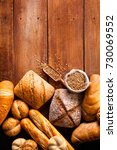 bread on wooden table  top view.   Shutterstock . vector #730069552