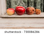 Small photo of four apples: an acerbic, a mature, an old, a march