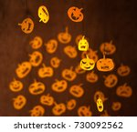 many funny pumpkins faces in... | Shutterstock . vector #730092562