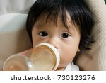baby being feed by bottle... | Shutterstock . vector #730123276