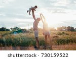 young happy family with little... | Shutterstock . vector #730159522