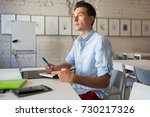 young handsome man sitting in... | Shutterstock . vector #730217326