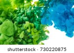 color drop in water close up | Shutterstock . vector #730220875