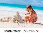 little girl at tropical beach...   Shutterstock . vector #730240072