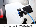 the process of charging an... | Shutterstock . vector #730241422