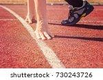 runner in start position. hands ...   Shutterstock . vector #730243726