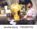 the chef prepares the foie gras ... | Shutterstock . vector #730285702