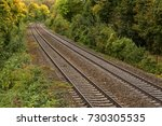 railroad tracks passing through ... | Shutterstock . vector #730305535