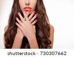 beautiful girl showing red... | Shutterstock . vector #730307662