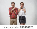 Stock photo emotional surprised happy woman and man wear glasses have unbelivable expression as see present 730310125