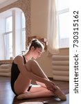 Small photo of Young ballerinas lesson. Thoughtful mood. Delicate sport kind, girl in dance class in focus on foreground. Sensibility from childhood, gym background, ballet concept